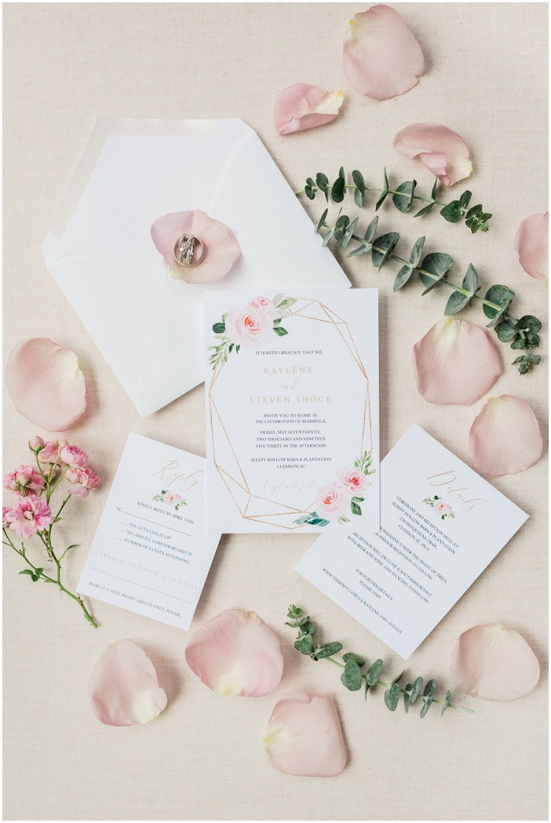 Blush inspired wedding invitation suite with greenery
