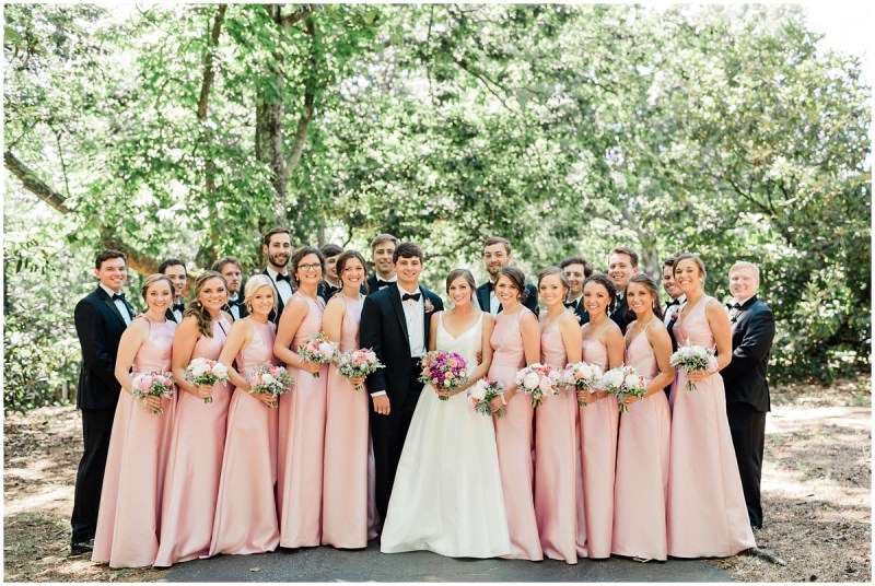Pink bridesmaids dresses with black tuxes