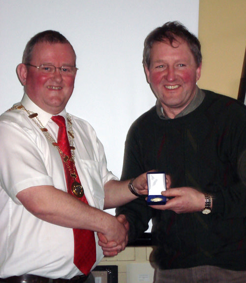 John Hooton receives his Gold medal from IPF President Mark Sedgwick.