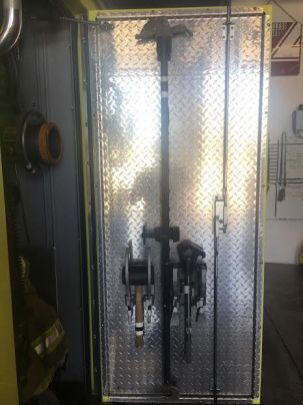 Hawk tool inside the door of Johnston-Grimes' pump compartment. [photo: Ty Wheeler, JGMFD]