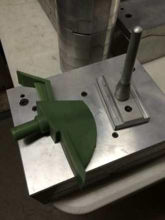 Wax positive of a Malven Hawk Tool head, mid-way through the multi-phased investment casting process.