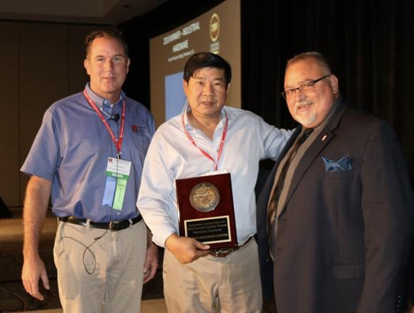 Fenico's Sonny Tran accepting the ICI's award for winning the ICI's award 2018 award for industrial hardware.
