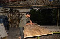 Kishan sawing wood to make handicraft wooden furniture in Shahadra , New Delhi. The wood used is from Assam. Artisans mostly bring finished products for sale. Only a part of goods showcased by Delhi artisans is manufactured in the city.