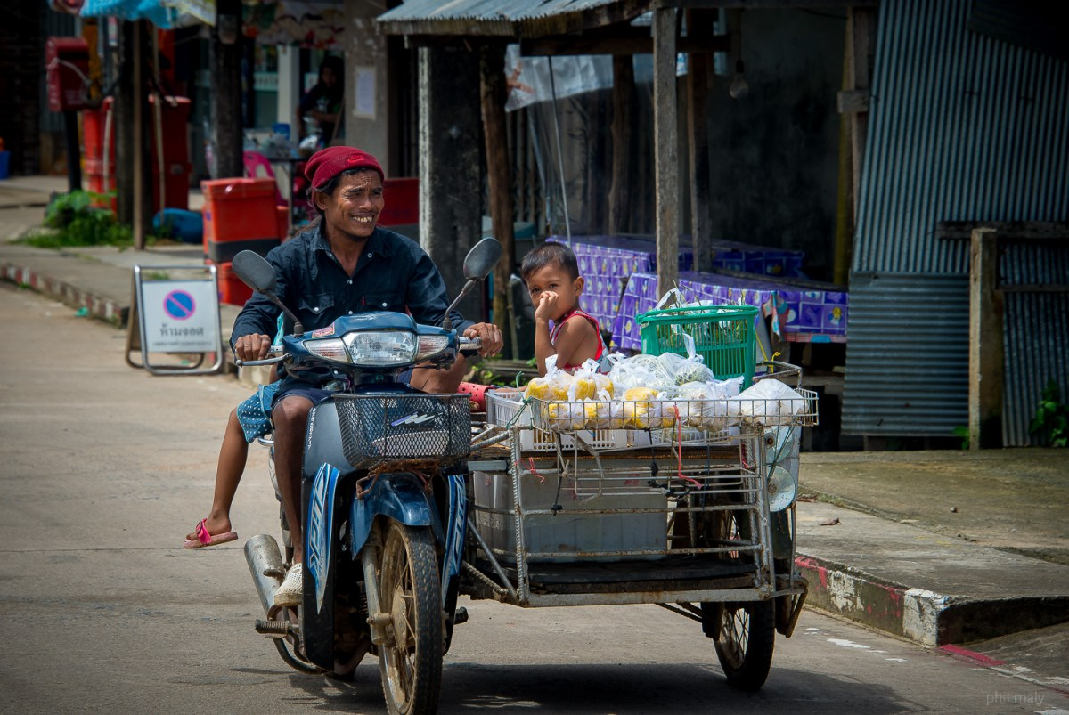 Thai family coming from the market