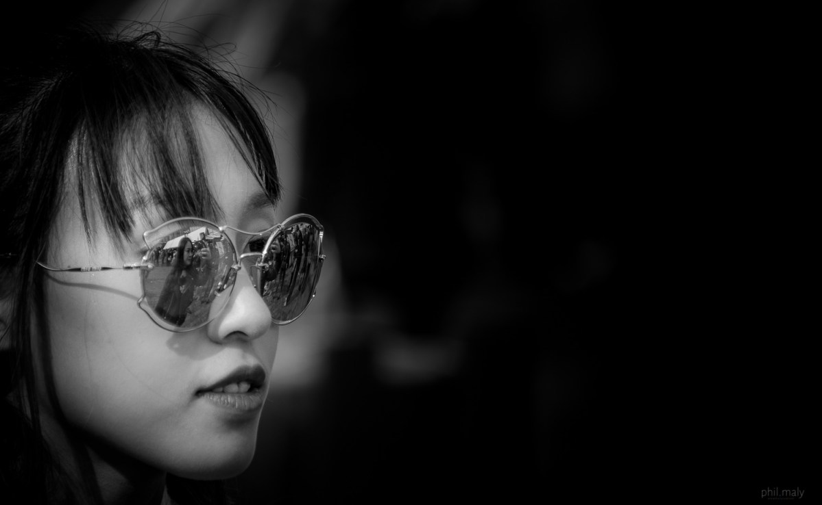 Street portrait of a Chinese girl with reflective glasses