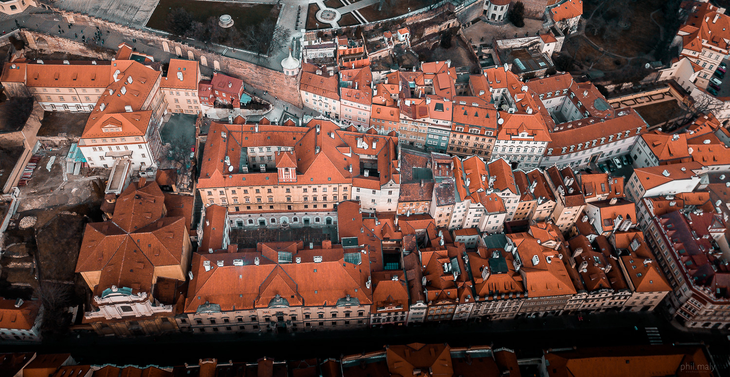 Drone shot of the small houses in the street from the Prag Castle