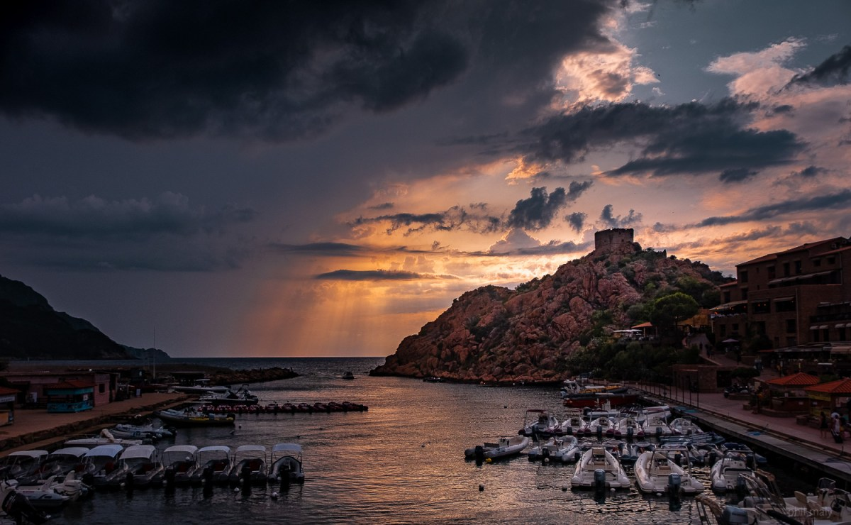 Dramatic sky during the sunset over the watchtower of Porto Ota