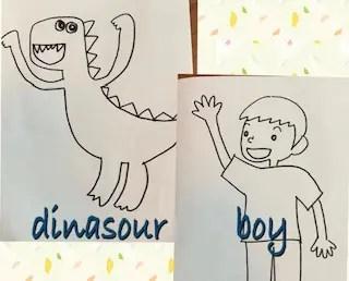 両手を挙げている恐竜と片手を挙げている男の子