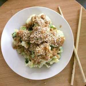 Broccoli Gomae. Crunchy broccoli tempura drenched in peanut sauce and topped with toasted sesame seeds.