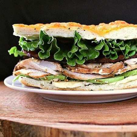 Roast Turkey Avocado Bacon on Focaccia. A fully loaded focaccia sandwich jam packed with roast turkey, avocado, crisp bacon and aged cheddar.