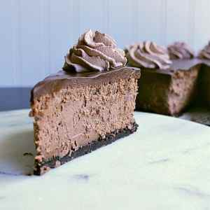 Quadruple Chocolate Cheesecake. Four layers of rich, sensational, chocolate love. Oreo crumb crust. Velvety chocolate cheesecake. Intense chocolate ganache. Fluffy chocolate whipped cream. This cheesecake is not for the faint of heart.