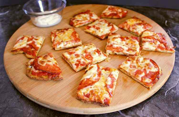 Cutting board with low carb pizza bites.