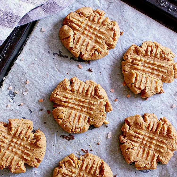baking sheet with freshly baked low carb peanut butter cookies.