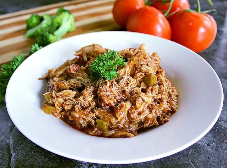 Bowl of shredded salsa barbecue chicken thighs.