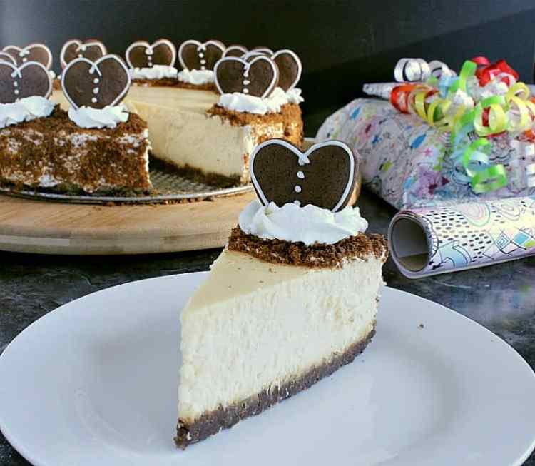 gingerbread crust cheesecake with one slice removed and decorated with hearts instead of trees.