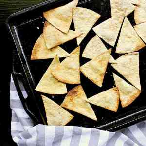 Low Carb Baked Tortilla Chips, laid out on a baking sheet, still warm from the oven.