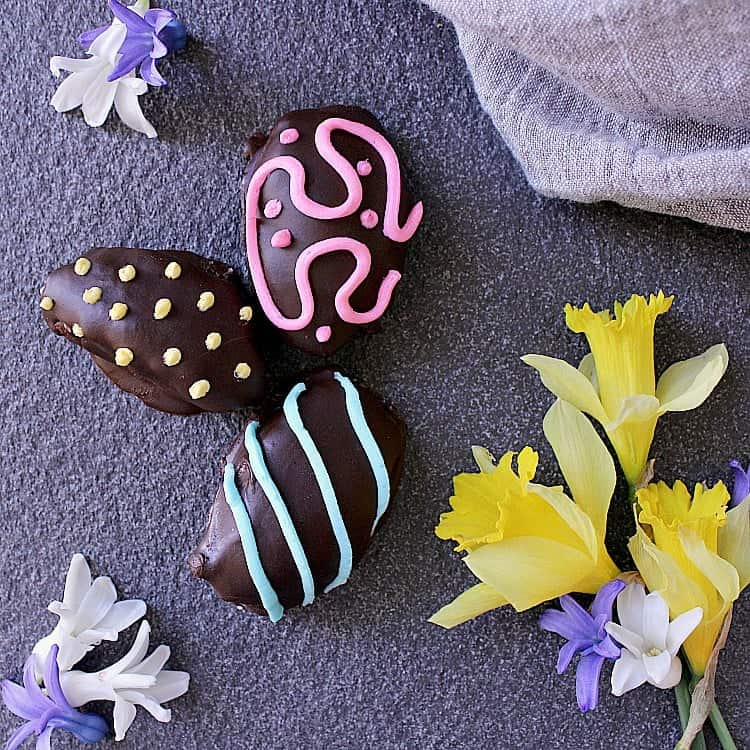 Three Low Carb Easter Eggs decorated with pink, blue and yellow.