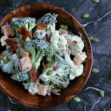 Single bowl of ranch cauliflower broccoli salad with bacon and cheese.