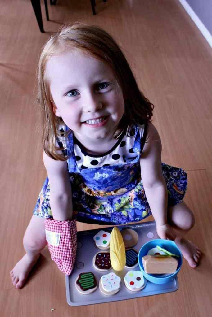 Zoey baking some pretend cookies.