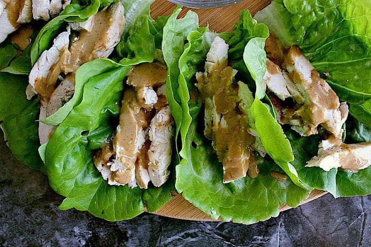 Butter lettuce leaves with chicken and peanut sauce.