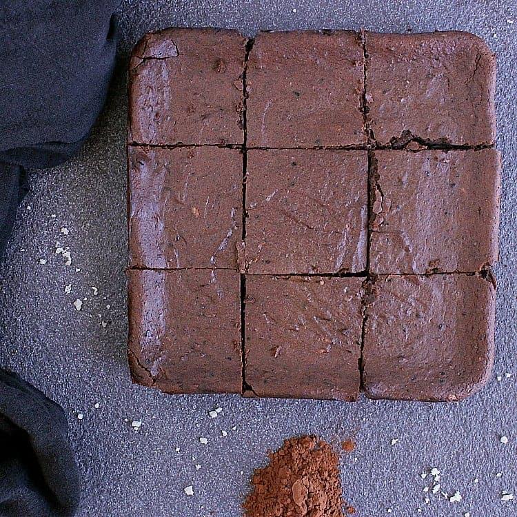 Keto chocolate brownie cut into 9 squares.