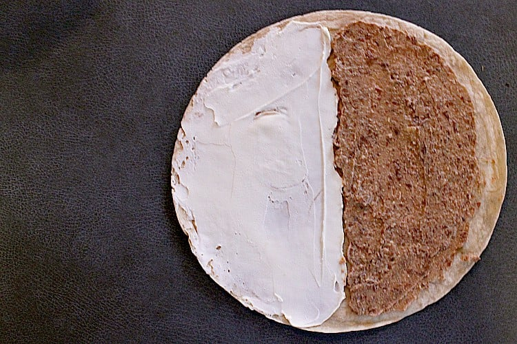 Low carb tortilla with cream cheese o one half and low carb refried beans on the other half.