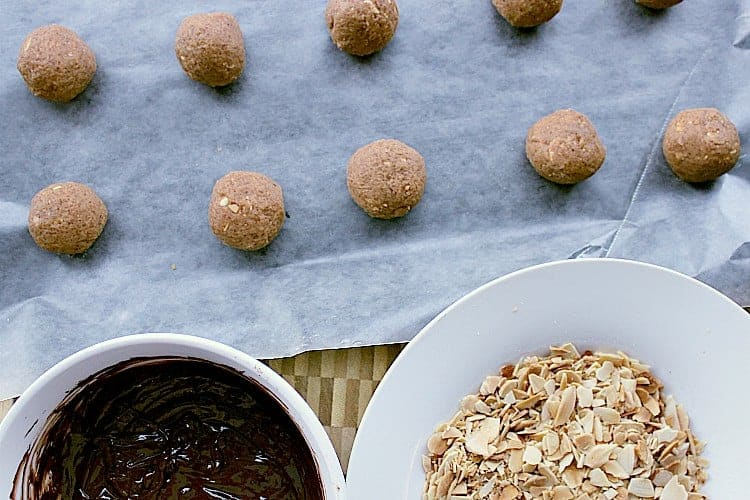 All prepped! The balls are beside the melted chocolate and slivered almonds.