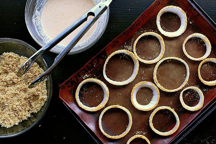 all rings tossed in almond flour and placed back on the baking sheet.