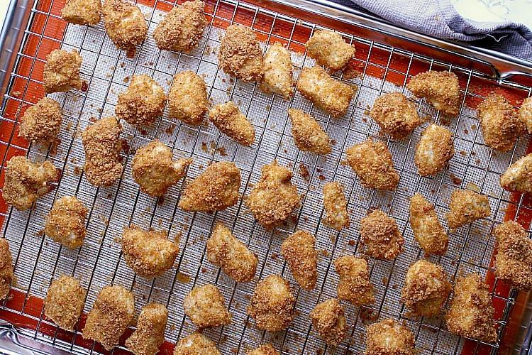 Freshly baked chicken, still hot on the baking sheet.