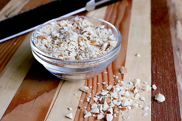 Small bowl of chopped up almonds.
