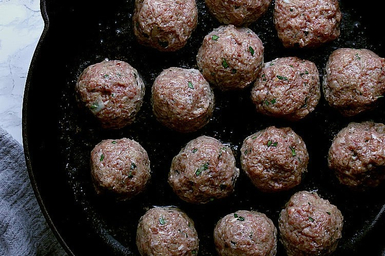 Balls in the hot cast iron skillet.
