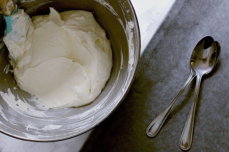 Cream cheese filling in a bowl, ready to be scooped into egg shapes.