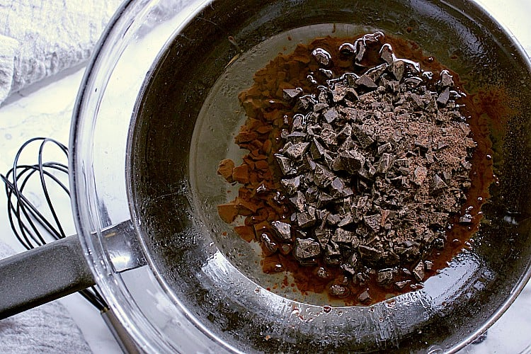 Bowl with melted oil and chopped chocolate.