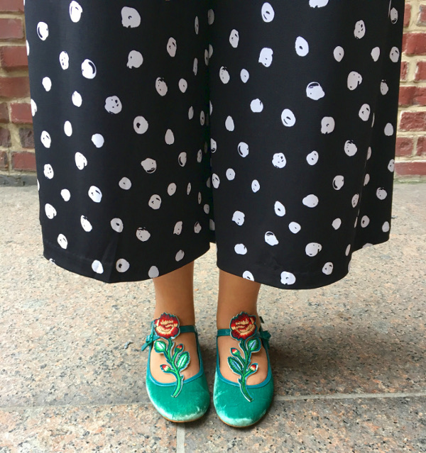 Polka dot palazzo pants and green velvet shoes
