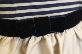 Velvet bow at waist