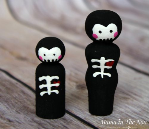 How to make friendly Halloween skeleton wooden peg dolls. Adorable not-so-spooky kid-friendly Halloween decorations.