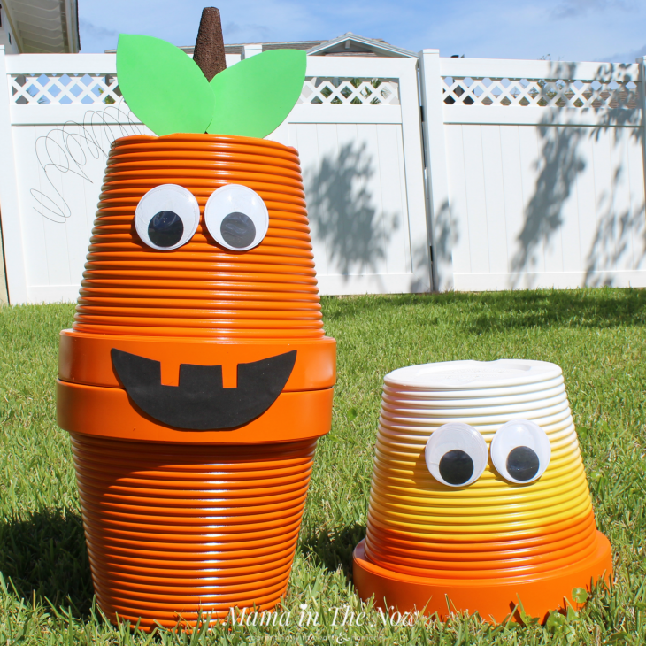 Candy corn and Pumpkin Jack O'Lantern fall decor for the front porch.Front porch decorations for fall. Upcycle old faded flower pots, adding spray paint and googly eyes. Not spooky Halloween front porch decorations. Family friendly outdoor Halloween and fall decorations. Upcycling, frugal and green living fall decorations. #FallDecorations #HalloweenDecorations #FrontPorchFallDecor