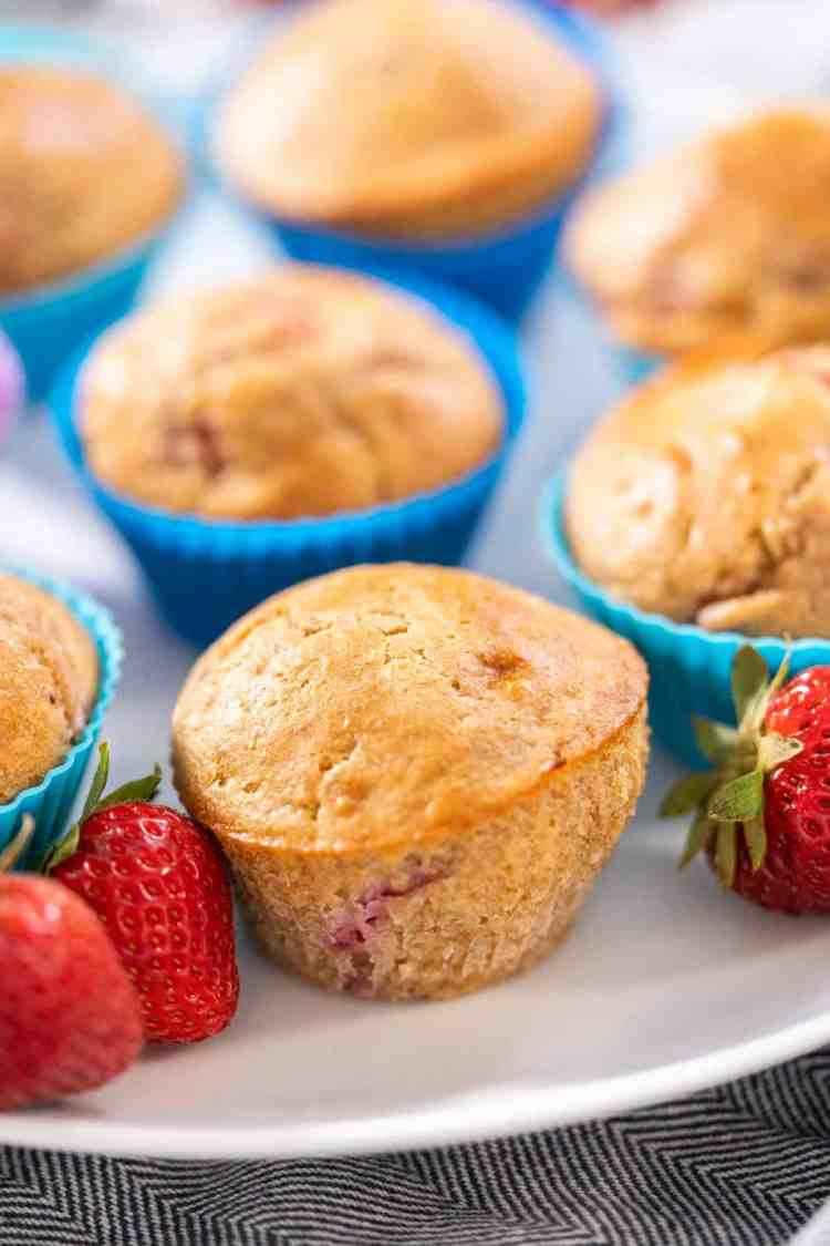 white whole wheat strawberry muffins with fresh strawberries