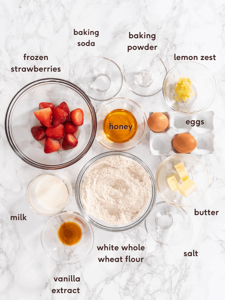 ingredients in healthy strawberry muffins recipe in glass bowls
