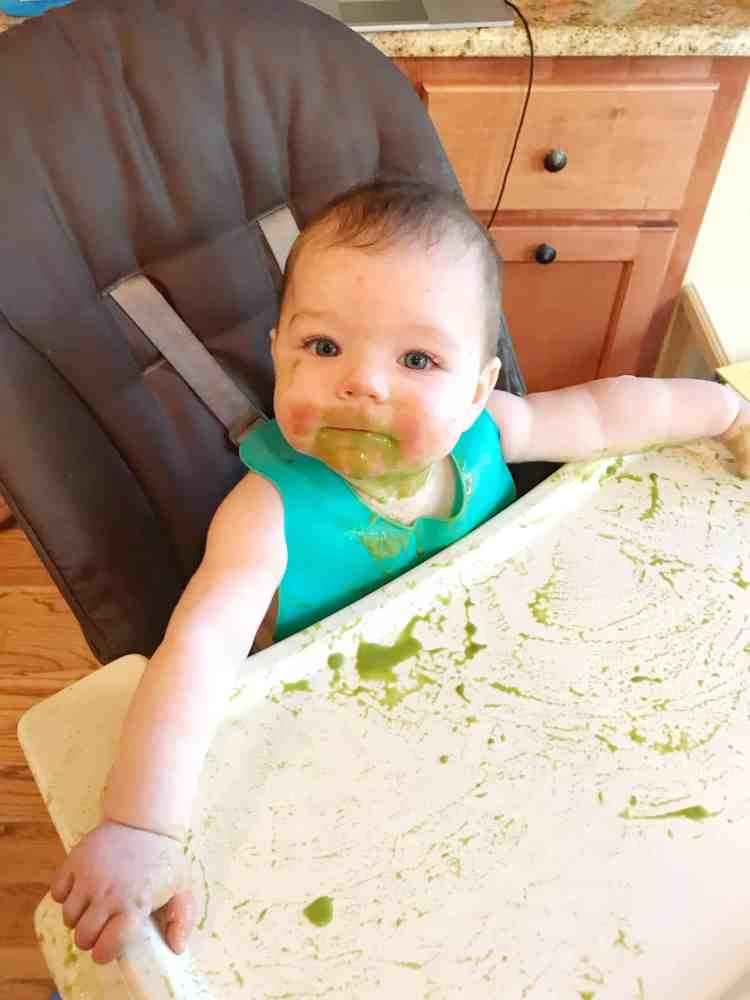 baby eating spinach puree baby led weaning
