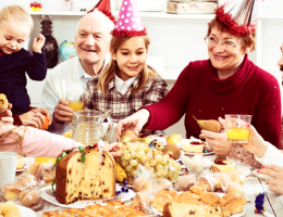 Large family eating holiday meal