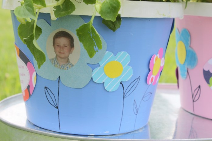 DIY decorated flower pot personalized with child's photo, perfect for Mother's Day or other gift. Makes a great classroom activity.