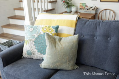 blue couch yellow and green accents