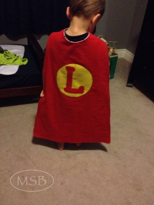 L modelling his cape