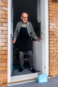 Social Distancing - Older Man at Door