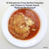 El Salvadorian Fried Stuffed Chayotes with Cheese in Tomato Sauce - Rellenos De Guisquil