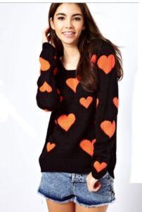 Suéter negro y naranja- Asos - 53 dólares