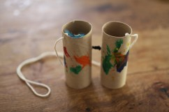 Binoculars. Same thing here - attach string on either sides and use a piece of pipe cleaner to attach the two tubes together in the centre.