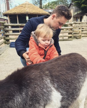 Stroking goats at the Village Barn