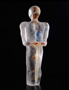 Glass sculpture of a standing figure holding a thin rod